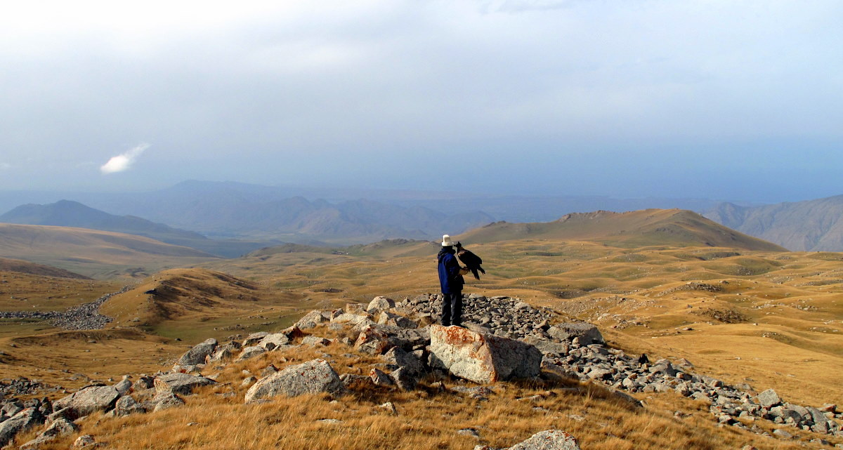 Ishenbek surveys the rolling expanse of the high steppe. 3968890120